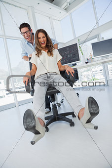 Designers having fun with on a swivel chair