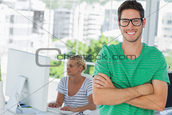 Attractive designer standing in his office