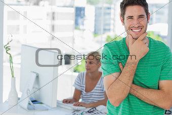 Attractive designer posing in his office