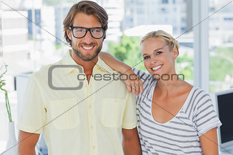 Attractive designer leaning on the colleagues shoulder