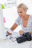 Cheerful photo editor looking at a contact sheet
