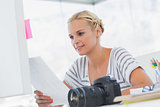 Pretty photo editor looking at a contact sheet