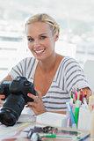 Photo editor looking at her digital camera