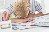 Overworked designer napping on her desk
