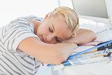 Overworked blonde designer napping on her desk