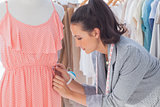 Creative designer adjusting dress