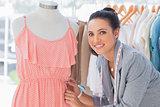 Creative designer measuring dress