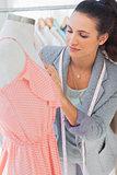 Attractive designer fixing dress