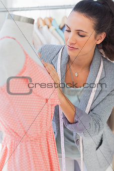 Attractive designer fixing dress