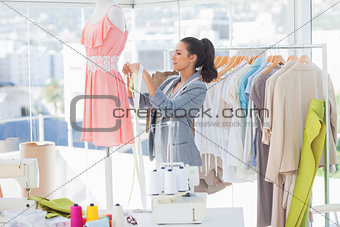 Attractive designer working on a dress