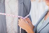 Fashion designer measuring blazer