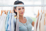 Attractive woman looking at clothes