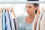 Fashion woman choosing clothes on clothes rail