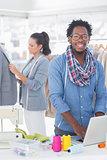Fashion designer smiling at camera