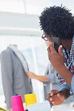 Fashion designer using his mobile phone