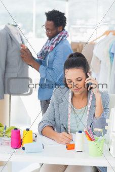 Attractive fashion designer calling