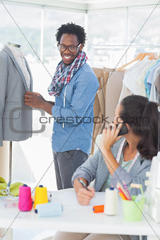 Group of fashion designers working together