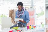 Fashion designer using digital tablet