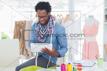 Attractive designer using tablet computer