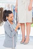 Designer picking needles on dress