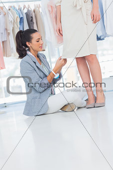 Attractive fashion designer sitting next to a model