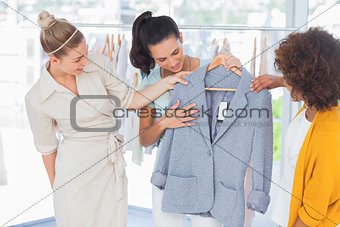 Attractive women looking at blazer