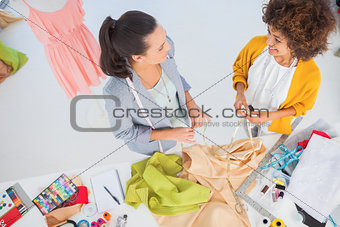 Attractive fashion designers working with textile