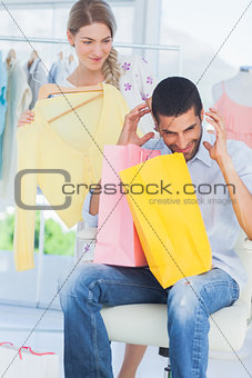Angry man while his girlfriend is shopping