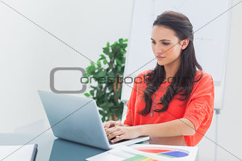 Pretty designer working on her laptop