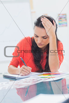 Overworked designer holding her head