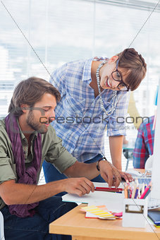 Pair of designers working on a document