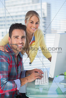 Portrait of smiling photo editors in their office