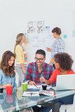 Happy designers brainstorming together