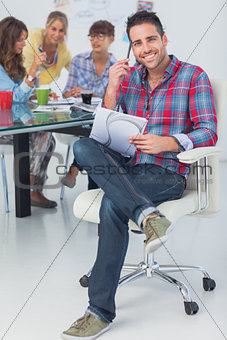 Attractive designer sit in his office