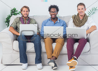 Portrait of handsome designers working with laptops