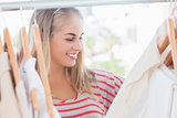 Cheerful woman looking at clothes