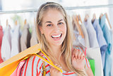 Cheerful woman standing in a clothing store