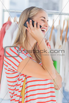 Blonde woman in a clothing store
