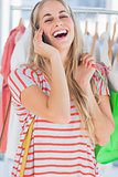 Blonde woman laughing in a clothing store
