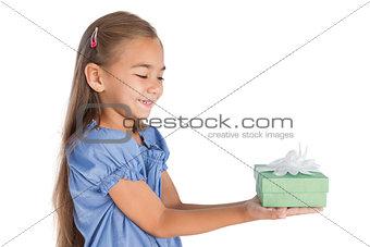 Blonde little girl giving a present