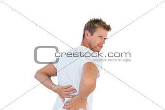 Handsome man suffering from back pain