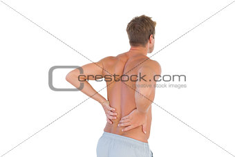 Shirtless man suffering from back pain