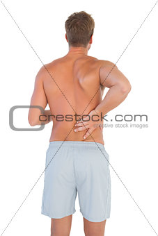 Man with shorts suffering from back pain