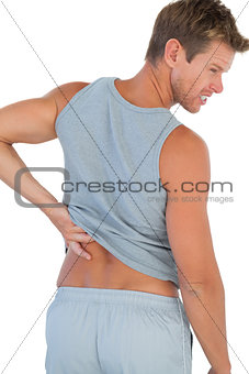 Man grimacing because of a back pain