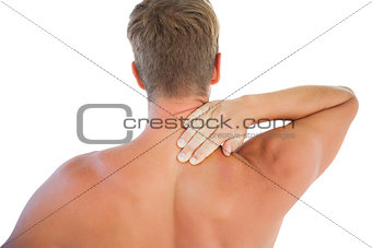 Muscled man having a neck ache