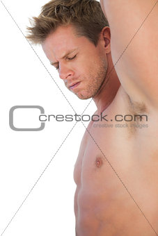 Attractive man with shorts suffering from neck pain