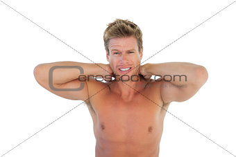 Shirtless man yelling and suffering from neck pain
