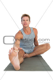 Handsome man working out on the floor