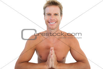 Cheerful man doing yoga and meditating