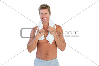 Shirtless man with a towel around his neck